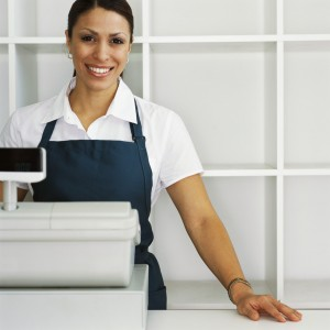 Smiling Cashier at Counter